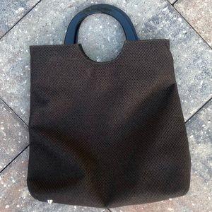 Classic brown handbag with black handles